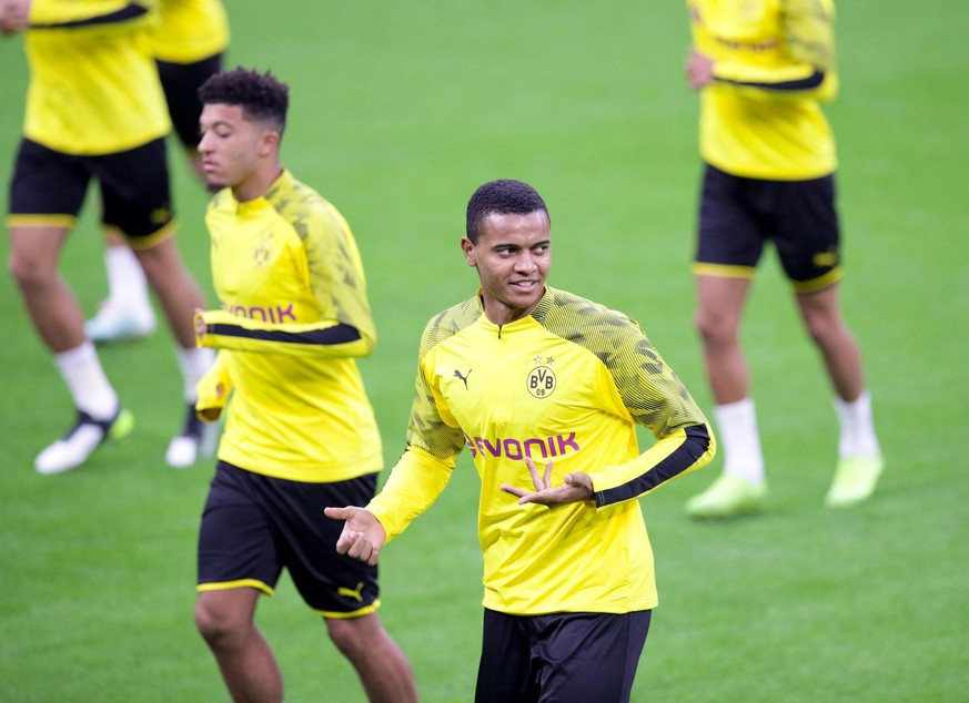 Borussia Dortmund's defender Manuel Akanji, center, attends a training session ahead of Wednesday's Champions League group F soccer match against Inter Milan, at the San Siro stadium, in Milan, Italy, Tuesday, Oct. 22, 2019. (Roberto Bregani/ANSA via AP)