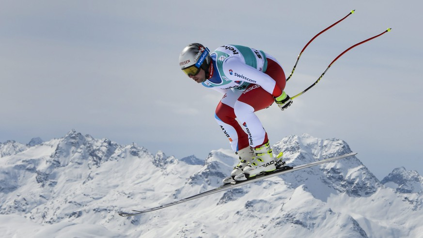 epa05212392 Beat Feuz of Switzerland in action during the men's downhill training session at the FIS Alpine Ski World Cup Finals, in St. Moritz, Switzerland, 15 March 2016.  EPA/JEAN-CHRISTOPHE BOTT