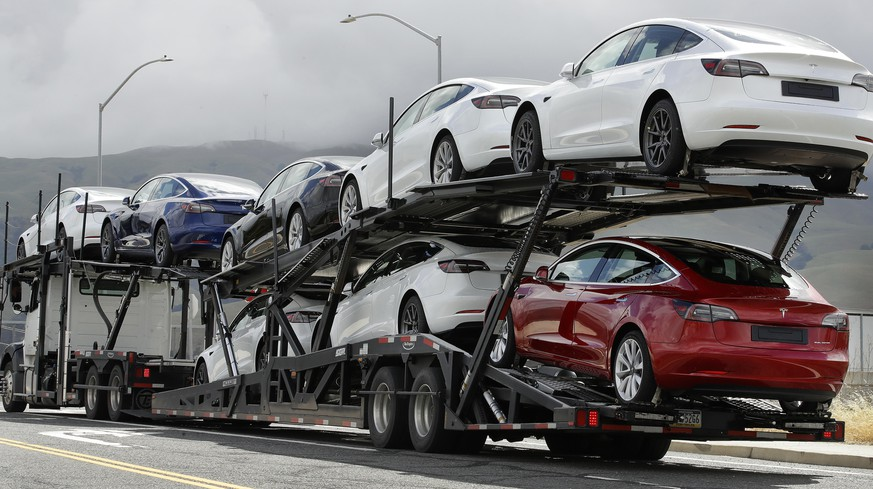 A truck loaded with Tesla cars departs the Tesla plant Tuesday, May 12, 2020, in Fremont, Calif. Tesla CEO Elon Musk has emerged as a champion of defying stay-home orders intended to stop the coronavirus from spreading, picking up support as well as critics on social media. Among supporters was President Donald Trump, who on Tuesday tweeted that Tesla's San Francisco Bay Area factory should be allowed to open despite health department orders to stay closed except for basic operations. (AP Photo/Ben Margot) Tesla Cars