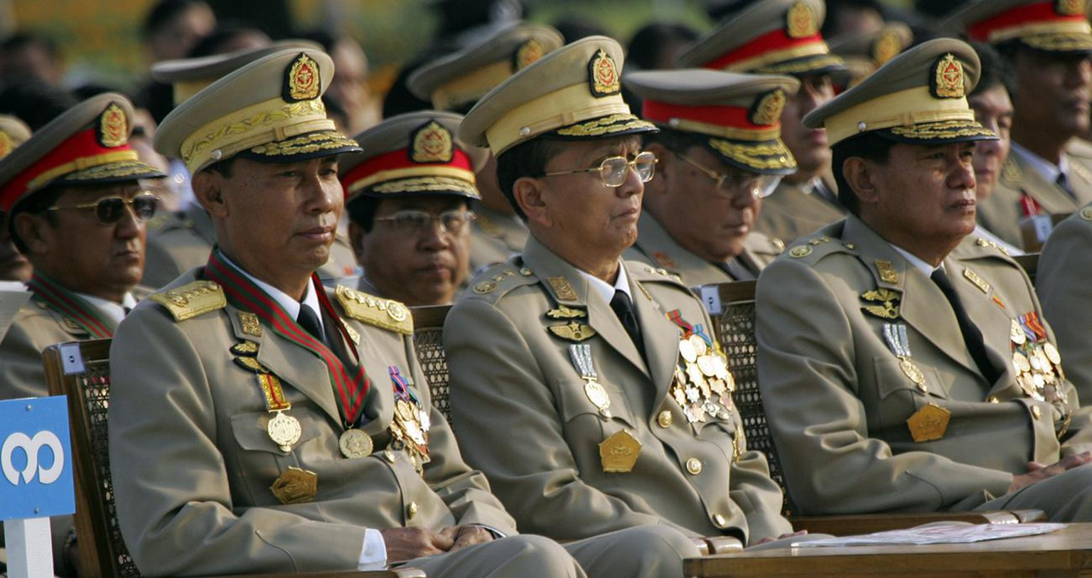 Myanmar junta leaders Gen. Thura Shwe, left, Lt. Gen. Thein Sein, center and Lt. Gen Kyaw Win, right, look on during 62nd annual Armed Forces Day ceremonies Tuesday, March 27, 2007, in the capital city of Naypyidaw, Myanmar. The cyclone that devastated Myanmar's heartland has also roiled a political landscape dominated by the military for more than four decades. But the ruling junta's grip on power remains. (AP Photo/David Longstreath)