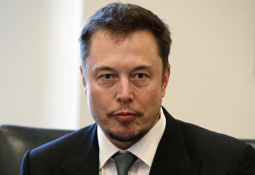 FILE - In this Dec. 14, 2016, file photo, Tesla CEO Elon Musk listens as President-elect Donald Trump speaks during a meeting with technology industry leaders at Trump Tower in New York. Musk has apologized for calling a British diver involved in the Thailand cave rescue a pedophile. In a series of tweets late Tuesday, the Tesla CEO said he had