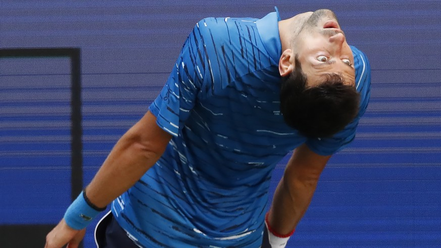 epaselect epa07795889 Novak Djokovic of Serbia reacts as he plays Roberto Carballes Baena of Spain during their match on the first day of the US Open Tennis Championships the USTA National Tennis Center in Flushing Meadows, New York, USA, 26 August 2019. The US Open runs from 26 August through 08 September.  EPA/JOHN G. MABANGLO
